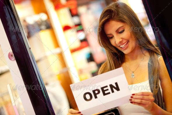 Stock Photo - PhotoDune Woman opening a retail store 1302392