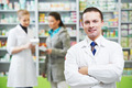 Confident pharmacy chemist man in drugstore - PhotoDune Item for Sale