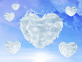 blue sky with clouds shaped as heart. Love concept