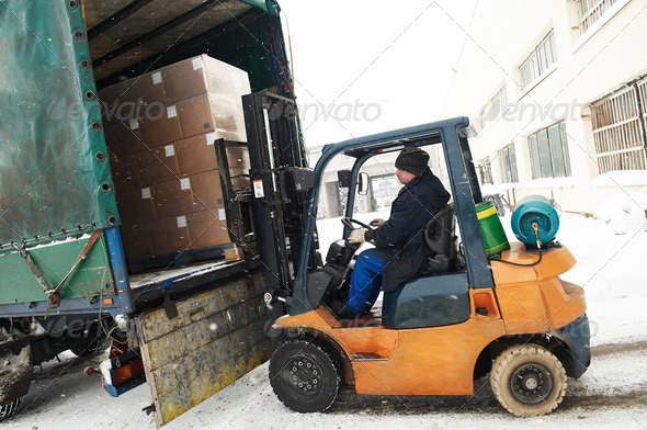 warehouse forklift loader work - Stock Photo - Images