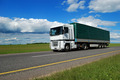 white lorry with green trailer