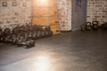 Dumbbells and kettlebell arranged at the gym