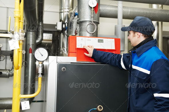 heating engineer repairman in boiler room - Stock Photo - Images