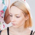 Young beautiful girl applying make-up.