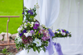 wedding arrangement of purple flowers