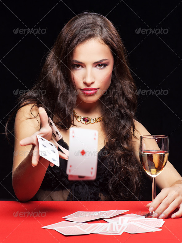 PhotoDune woman gambling on red table 1318078