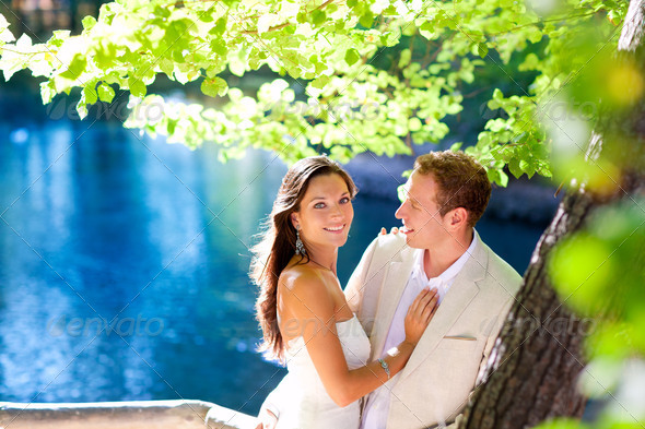 Stock Photo - PhotoDune couple in love hug in forest tree blue lake 1318661
