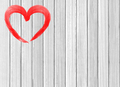 red heart paint on white wooden background