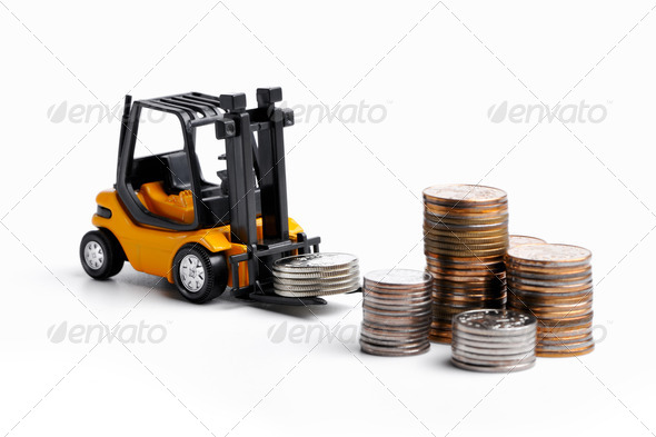 Yellow toy forklift and money - Stock Photo - Images