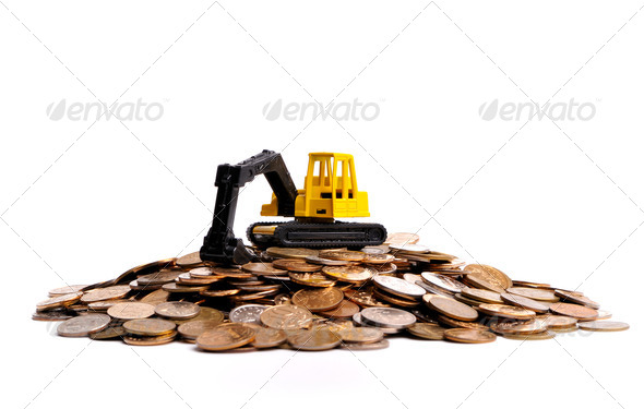 Yellow excavator on a big heap of coins - Stock Photo - Images