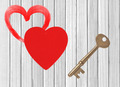 red heart and key white wooden background