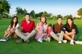 family friends group people sitting green grass - PhotoDune Item for Sale