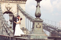 Beautiful bride and groom celebrating their wedding in the city