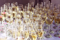 Many glasses filled with champagne at wedding reception