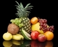 Group of many fruits-grapes,pomegranate,avocado isolated on blac
