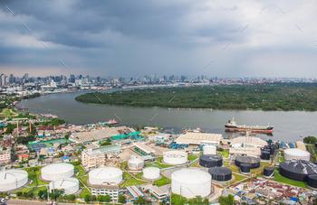 Industrial waterfront with dark skies