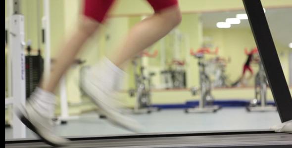 Woman Exercising Against Mirror