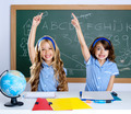 clever students in classroom raising hand - PhotoDune Item for Sale