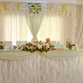 Banquet wedding table with dishware.