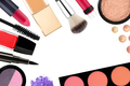 Beautiful decorative cosmetics and makeup brushes, isolated on w