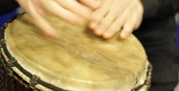 [VideoHive 1335508] Playing a Djembe in the Studio | Stock Footage
