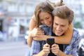 Couple or friends funny with a smart phone