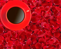 red coffee cup on beautiful red rose petals background
