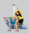Teenager girls dancing breakdance in action