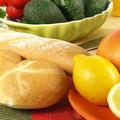 Juicy citrus fruit on orange plate, square