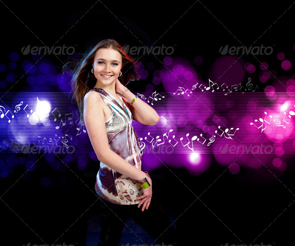 young woman dancing at disco - Stock Photo - Images