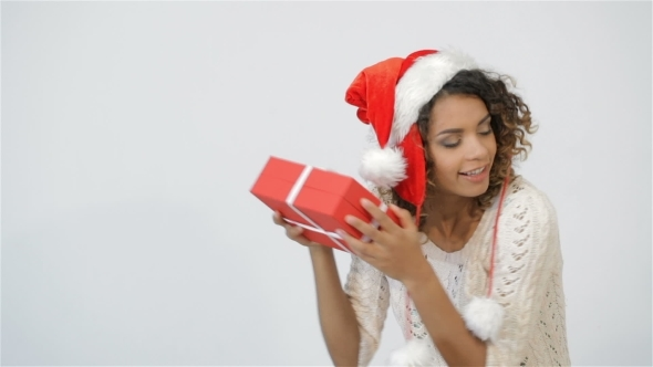 Pretty Girl Shaking Christmas Gift