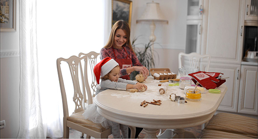 Mom and daughter cooking gingerbread
