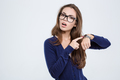 Woman pointing finger on wrist watch