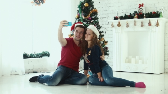 Couple Makes Christmas Selfie