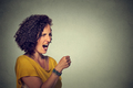 Angry woman screaming with fist up in air