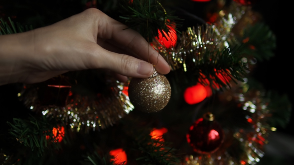 Hand Putting Christmas Ball