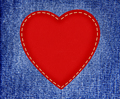 red textile heart on fabric jeans in grunge style