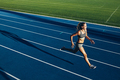 Female sprinter training for race competition