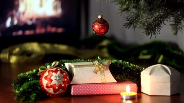 Christmas Tree Near a Fireplace.