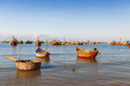 Fishing village, market and colorful traditional fishing boats n