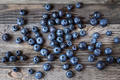Blueberry  lie on wooden background. Rustic cozy background with healthy food.