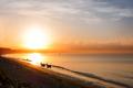 Impressive sunrise near Mui Ne, Vietnam. Fishermen preparing to go fishing.