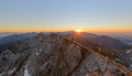 Male hiker at the top of the big mountain at Sunrise