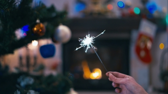 Sparklers On The Background Of Christmas Tree