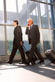two businessmen with trolley