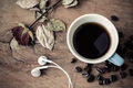 earphone with coffee on old wooden table