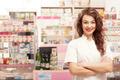 Friendly smiling medical worker  in front of her desk
