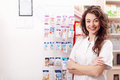 Smiling healthcare system worker in pharmacy