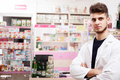 Doctor in drugstore in front of the desck