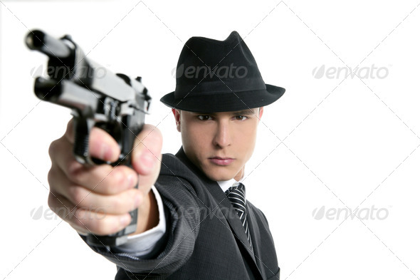 Classic mafia portrait, man with black suit and gun - Stock Photo - Images